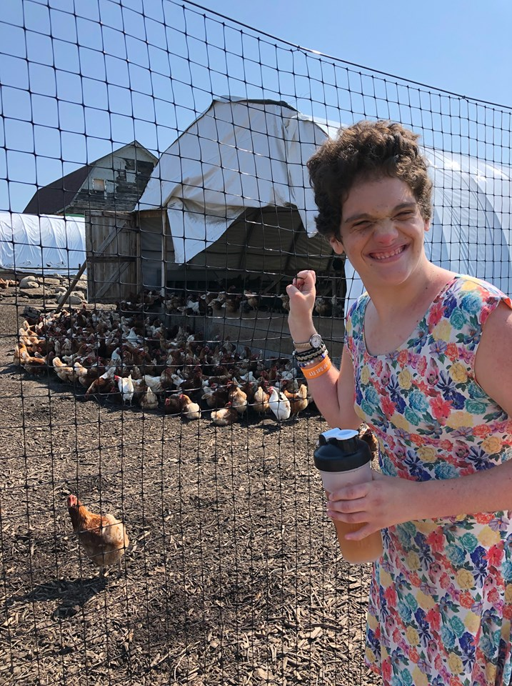 Camp participant with chickens